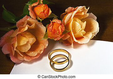 Wedding rings, roses and ticket