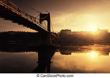 sunset and footbridge in Lyon city in France