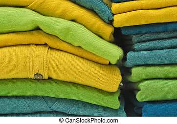 Stack of women's sweaters and cardigans in bright vivid colours
