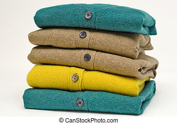 Stack of women's V-neck cardigans in bright vivid colours...