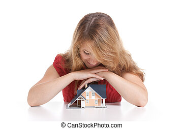 Dream about house - Young woman with model of house.