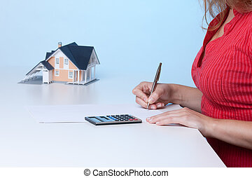 Real estate broker calculating amount of payments family...