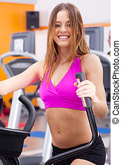 Young fit woman doing cardio exercise