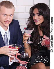 Couple on date in bar or night club enjoying wine