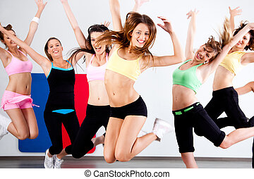 Enthusiastic group of women having fun during aerobics...