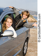 mother and son in new hire or rented car on vacation