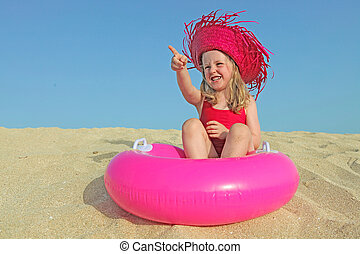 happy kid on vacations on beach pointing