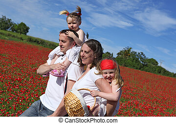 happy healthy family going for walk in countryside