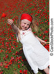 young child picking and giving flower