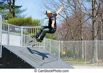 Skateboarder On a Skate Ramp - Action shot of a skateboarder...