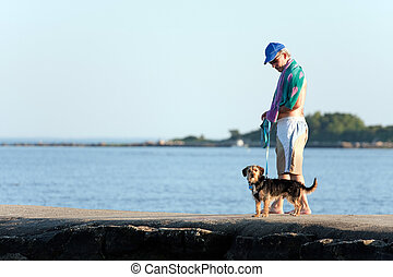 Middle Aged Man Walking His Dog