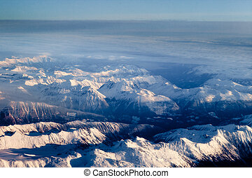 Aerial view of snowcapped peaks in BC, Canada - Snow covered...
