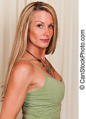 Tank top - Beautiful mature blonde in a green tank top