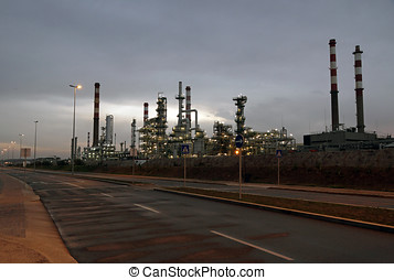 Oil refinery at dawn - Oil refinery near a road in the early...