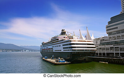 Cruise ship in harbour - White luxury cruise ship in...