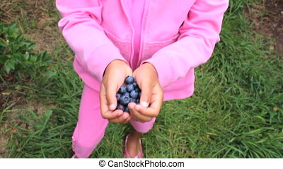 Proud Girl With Fresh Blueberries - An cute little Asian...