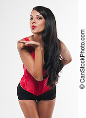 Red bustier - Beautiful young multiracial woman in a red...