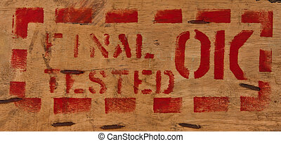 "Text ""final tested ok"" on wood"