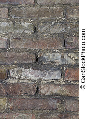 background or texture of a old wheathered an repaired brick wall
