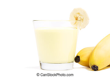 banana milkshake with a piece of banana and bananas aside on...