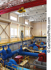 Water pumping station - Industrial interior and pipes. Water...