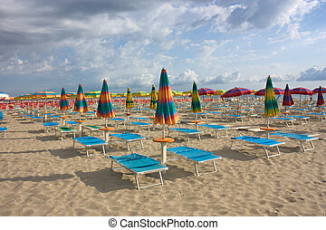 umbrellas on the beach - beach with umbrellas and sunbeds...