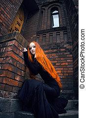 Redhead girl - Beautiful redhead girl in black dress near...