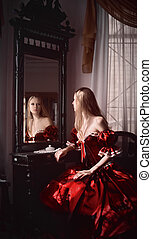 Woman and mirror - Portrait of woman and her reflection in...