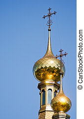 Domes of an orthodox temple - Two gilt domes of an orthodox...