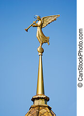 Weathervane. Blowing Angel. - Gilded weather vane in the...