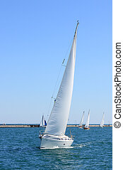 white sailing boat at sea