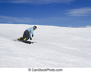 Snowboarder against beautiful sky - Snowboarder on ski slope...