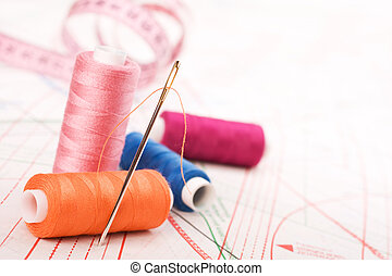 Spool of thread and needle. Sew accessories. - Spool of...