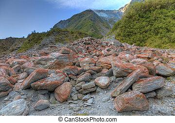 Landslide - Image of rocks at the bottom of an alpine...