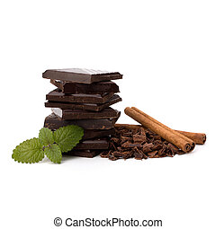 Chocolate bars stack and cinnamon sticks isolated on white...