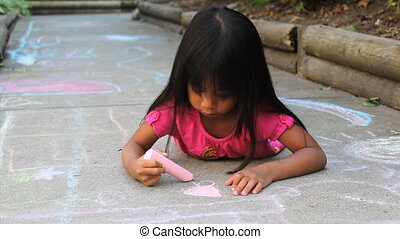 Girl Colors Pink Flower On Sidewalk - A cute little Asian...