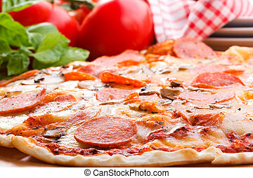 Pepperoni pizza and fresh vegetables