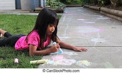 Cute Asian Girl Doing Sidewalk Art - A cute little Asian...