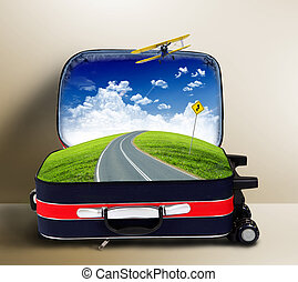 Red suitcase with landscape and road inside