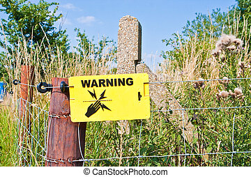 Electric fence - Warning sign for an electric fence in a...