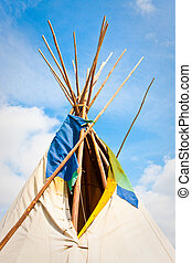 Wigwam - Top of a traditional wigwam against a bright blue...