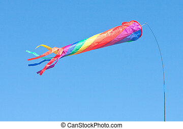 Colourful flag - A colorful toy flag or windsock blowing on...