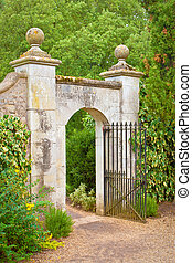 Gate - A nice gate in a stone wall in an english garden