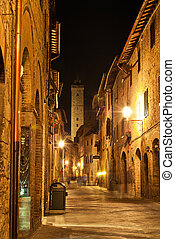 Streets of San Gimignano, in the night - San Gimignano is a...