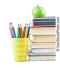 Textbooks and notebooks next to the pencils and green apple on top