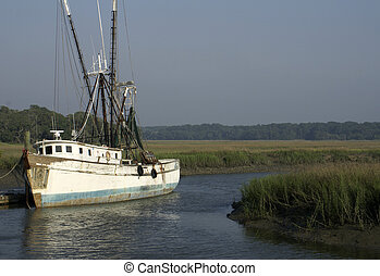 Old Shrimp Boat at Dock - An old shrimp boat docked in a...