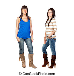 Two pretty girls with jeans isolated on a over white...
