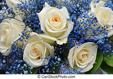 Wedding bouquet with white roses and blue flowers