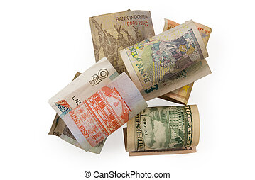 Different banknotes rolled into coils