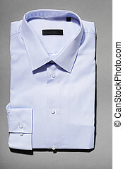 New Shirt - A light blue new men's dress shirt on grey...